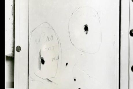 Marked Bullet Holes in Door Frame